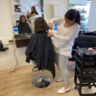 Cheryl cutting clients hair